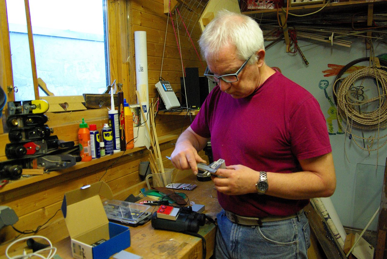 Man working on building something in a workshop
